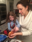Rina helping Mama make homemade Sufganiot, the traditional Hanukkah jelly-filled donuts.