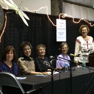 "CWC and WNBA activities dovetail! ""Women Writing about the 1960s and 1970s"" panel at the Literary Arts Stage, San Mateo County Fair: (l to r) authors Sue Barizon, Marianne Goldsmith, Lynn Sunday, Darlene Frank, and I am the moderator, standing."